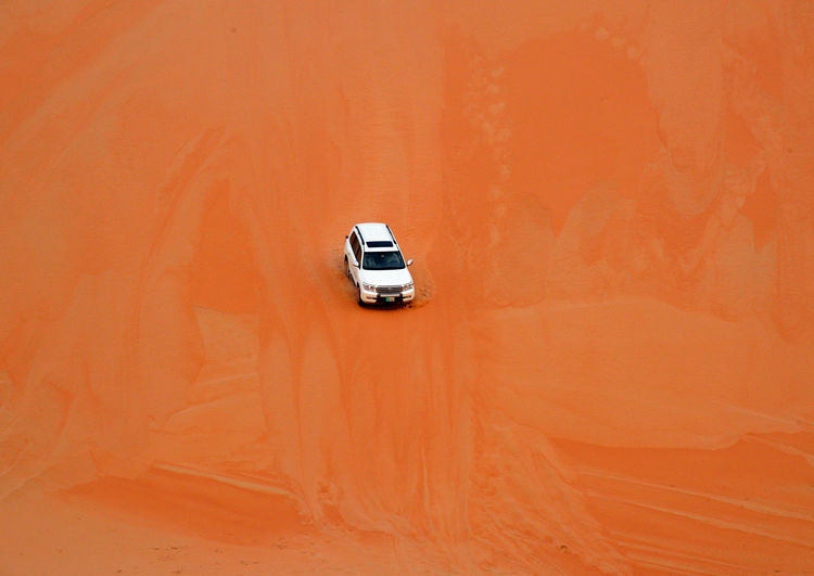 Desert EyeEmNewHere Arid Climate Beauty In Nature Car Climate Day Journey Land Vehicle Mode Of Transportation Motion Motor Vehicle Moving Nature No People Off-road Vehicle on the move Orange Color Outdoors Road Road Trip Sports Utility Vehicle Transportation Travel Van - Vehicle