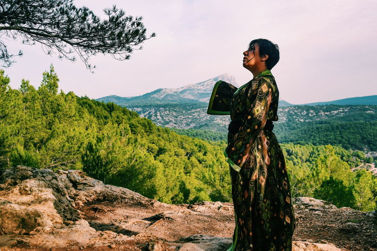 one year serie: culture and identity One Person Standing Traditional Clothing Morrocan Style Tree Beauty Mountain Rural Scene Women Tradition Sky Landscape Plantation A New Beginning Autumn Mood