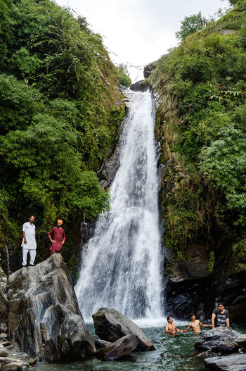 Beauty In Nature Casual Clothing Day Flowing Flowing Water Long Exposure Motion Mountain Nature Non-urban Scene Outdoors Power In Nature Remote Rock Rock - Object Rock Formation Scenics Splashing Tranquil Scene Water Waterfall