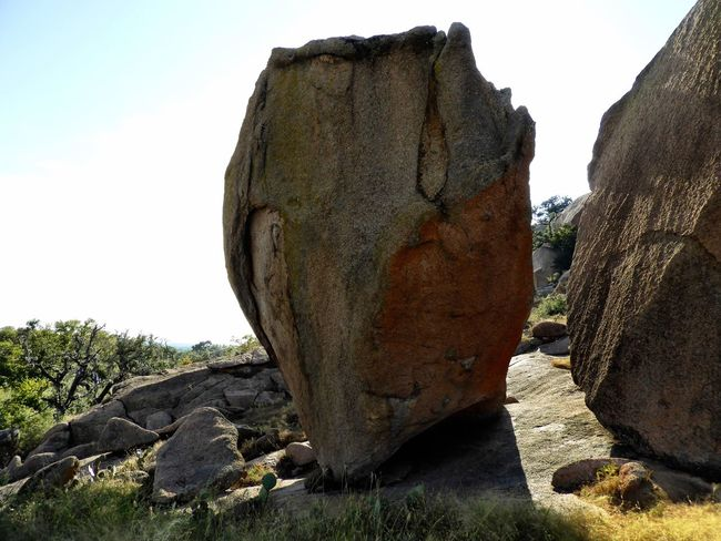 Two massive, back-lit granite boulders. Rock - Object Rock Formation Nature Geology Day Scenics Beauty In Nature Landscape Outdoors No People Cliff Travel Destinations Physical Geography Tranquility Sky Clear Sky Tree