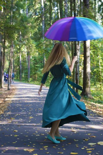 Park Autumn One Person colour of life Tree Real People Full Length Women Leisure Activity Rear View Walking Day Nature Umbrella Outdoors Standing
