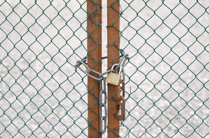 Locked Backgrounds Barbed Wire Chainlink Fence Close-up Closed Day Fence Full Frame Gate Lock Locked Up Metal No People Outdoors Padlock Pattern Prison Protection Safety Security Security System