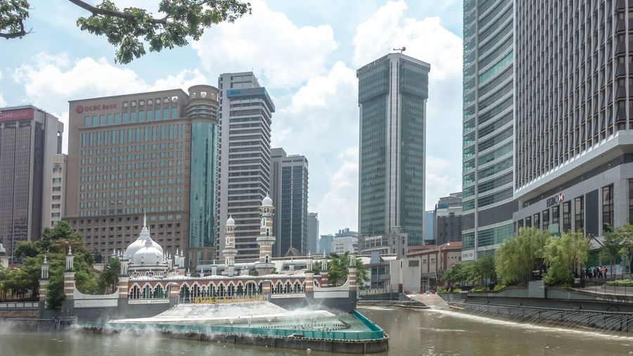 Meeting between two rivers close to Jamek mosque Kuala Lumpur Historical Building Sightseeing Tourist Attraction  Architecture Building Building Exterior Built Structure City Cityscape Cloud - Sky Day Gombak River Klang River Masjid Jamek  Modern Mosque Office Outdoors Plant Sky Skyscraper Tall - High Tower Tree Water