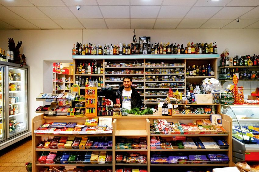 """""""Späti Portraits Nr. 5"""" - Späti owners are always on high alert on Sundays. Opening shop on Sundays is a legal grey area and particularly vindictive police officers can write hefty fees. Berliner Späti Portraits Berlinspätis Series Myfuckingberlin Cornerstore Spätkauf SoBerlin Multicolored Wideangle Fujilove Fujinon14mm Business Choice Store Retail  Consumerism Business Finance And Industry Variation For Sale Small Business Supermarket Shelves Groceries Produce Aisle Retail Display Market"""