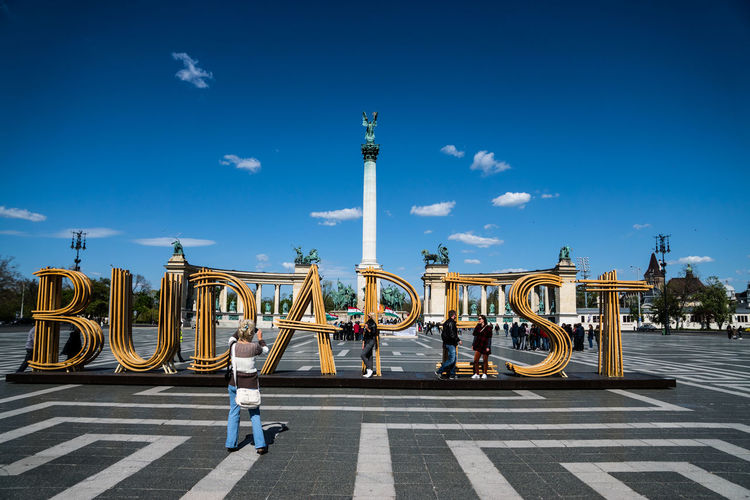 Text And Millennium Monument Against Sky At Hero Square In City