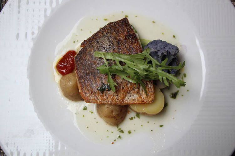 Fish, potatoes and purple cauliflower on white plate Califlower Close-up Directly Above Fish Food Food And Drink Freshness Garnish Healthy Eating Indoors  No People Plate Potato Ready-to-eat Serving Size Still Life Table Temptation Tomato Vegetable Wellbeing