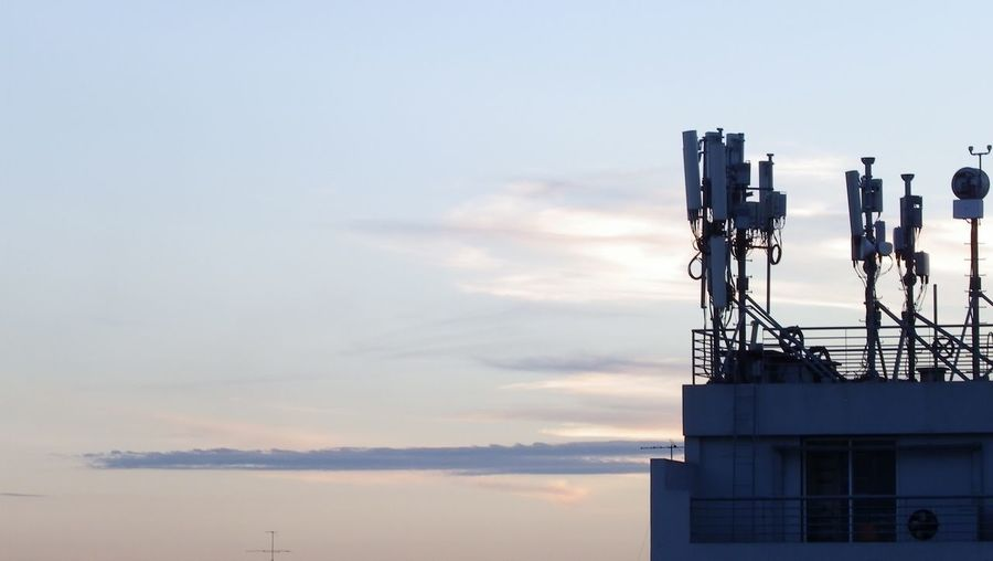 View of telecommunications equipment against sky