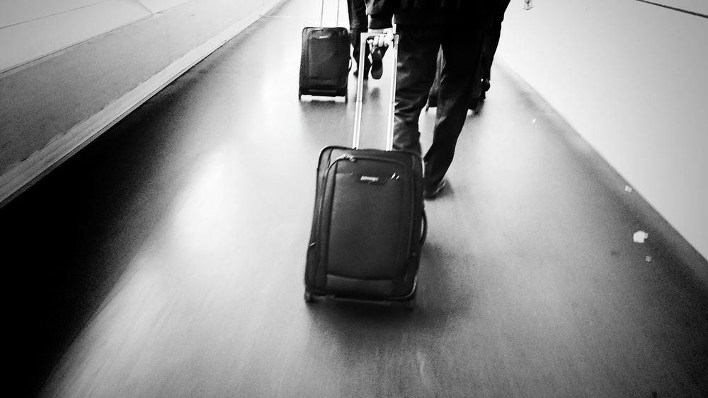 Travelling the world Starting A Trip Transportation Journey Black & White Black And White Blackandwhite Suitcase Airport Airportlife Walking Business Trip Businessman Business Life Walking The Line Bag Streetphotography