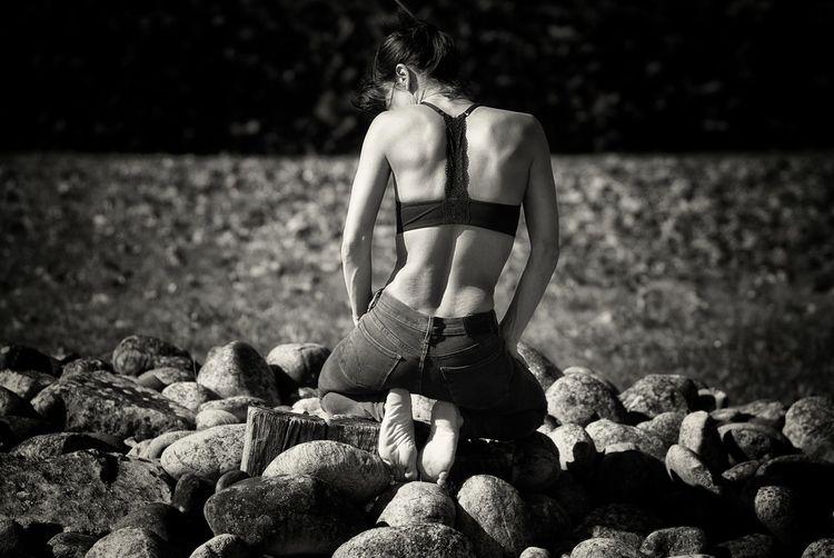Rear view of woman on rocks