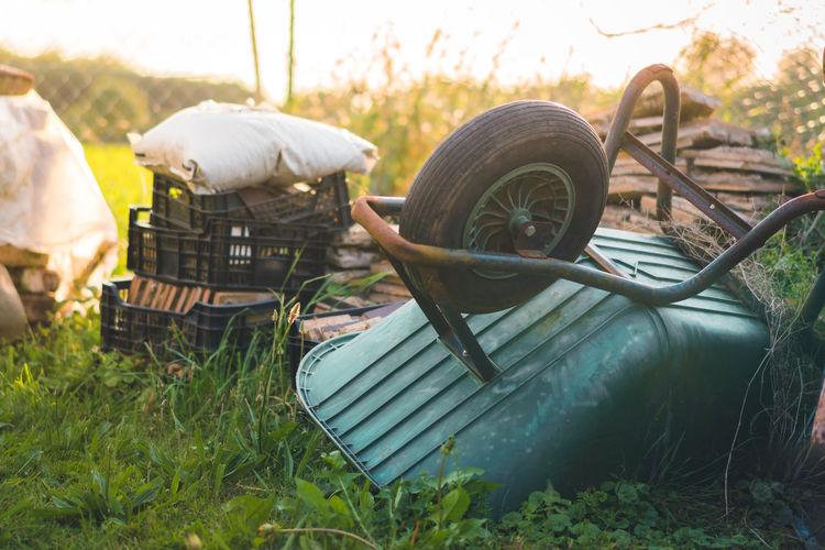 Wheelbarrow on field