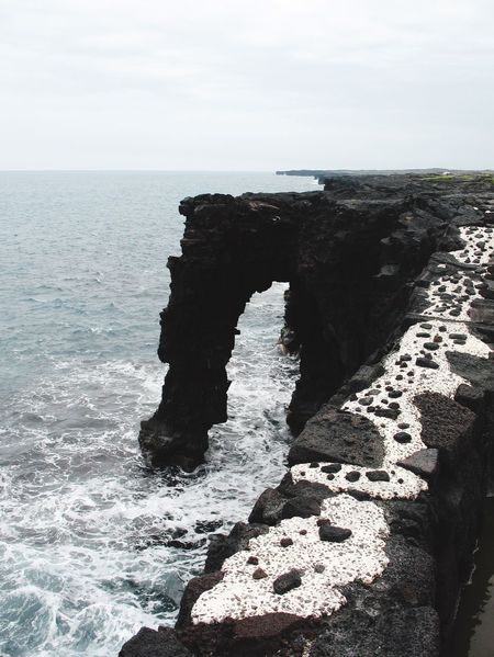 Big Island Hawaii Volcanoes National Park Arid Landscape Sea And Sky The KIOMI Colllection Volcanic Landscape Volcanic Stone Volcanic Landforms Arch Rock Volcanic Rock No People Seascape Showcase April