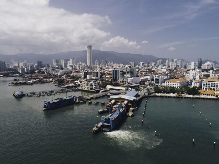 Harbor against buildings in city