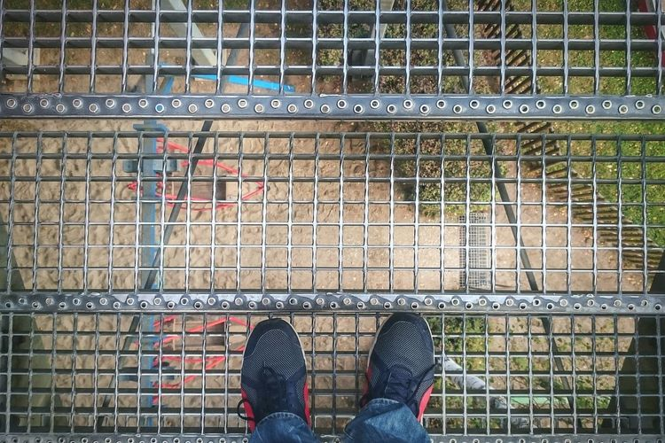 Shoe Standing Personal Perspective Human Foot Outdoors Day Shoes Multi Colored Footwear Low Section POV My Point Of View Metal Stairs_collection Stairs Stairs To Heaven Looking Through Looking From Above High Dizziness EyeEm Best Shots Focus On Foreground Sony Xperia Sonyz3compact Grid