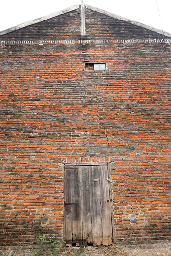 Low angle view of brick wall of old building