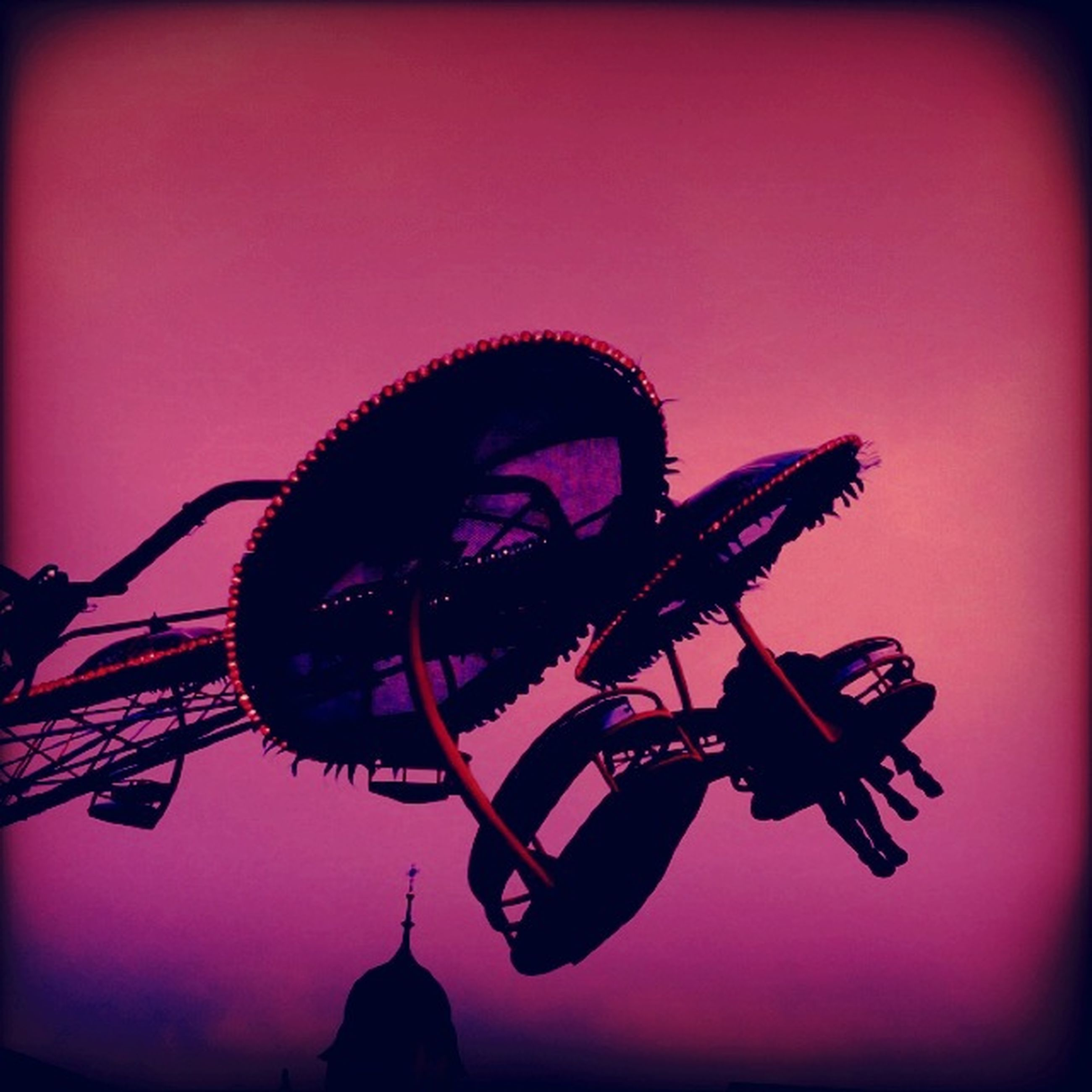 transfer print, auto post production filter, arts culture and entertainment, low angle view, sky, silhouette, amusement park, illuminated, clear sky, amusement park ride, ferris wheel, night, copy space, sunset, dusk, vignette, outdoors, no people, red, celebration