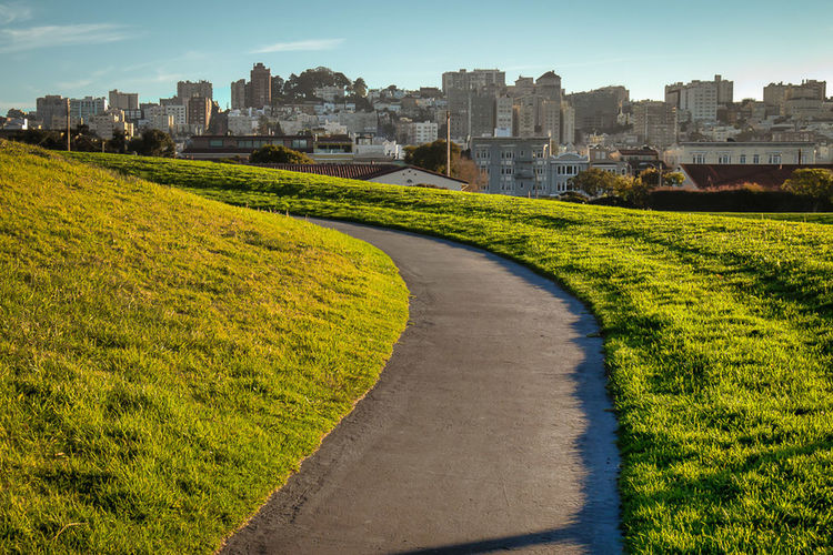 The Hilltop Path - A path crests a hill in the Great Meadow at Fort Mason as the late afternoon sun begins to set on San Francisco. San Francisco Travel Fort Mason