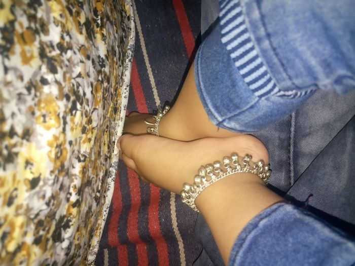 Low section of baby girl wearing anklet