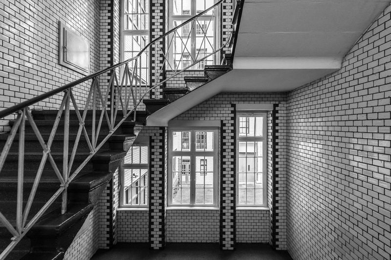 Black And White Krull&Krull Black And White Stairway Best Of Stairways Architecture Built Structure Staircase Building Steps And Staircases No People Window Building Exterior Railing Day Wall Fire Escape Brick Wall Safety Brick Security Outdoors Wall - Building Feature City Apartment