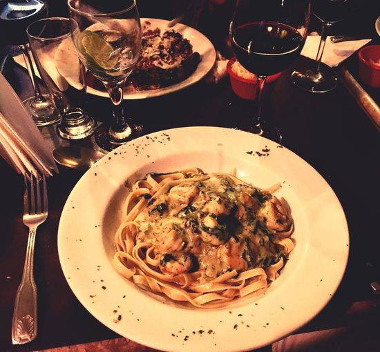 Shrimps fettuccine Fettucini Shrimps Plate Table Food And Drink Pasta Fork Serving Size Food Italian Food Ready-to-eat Restaurant Wineglass Spaghetti Healthy Eating Drinking Glass Wine Meal Food Stories