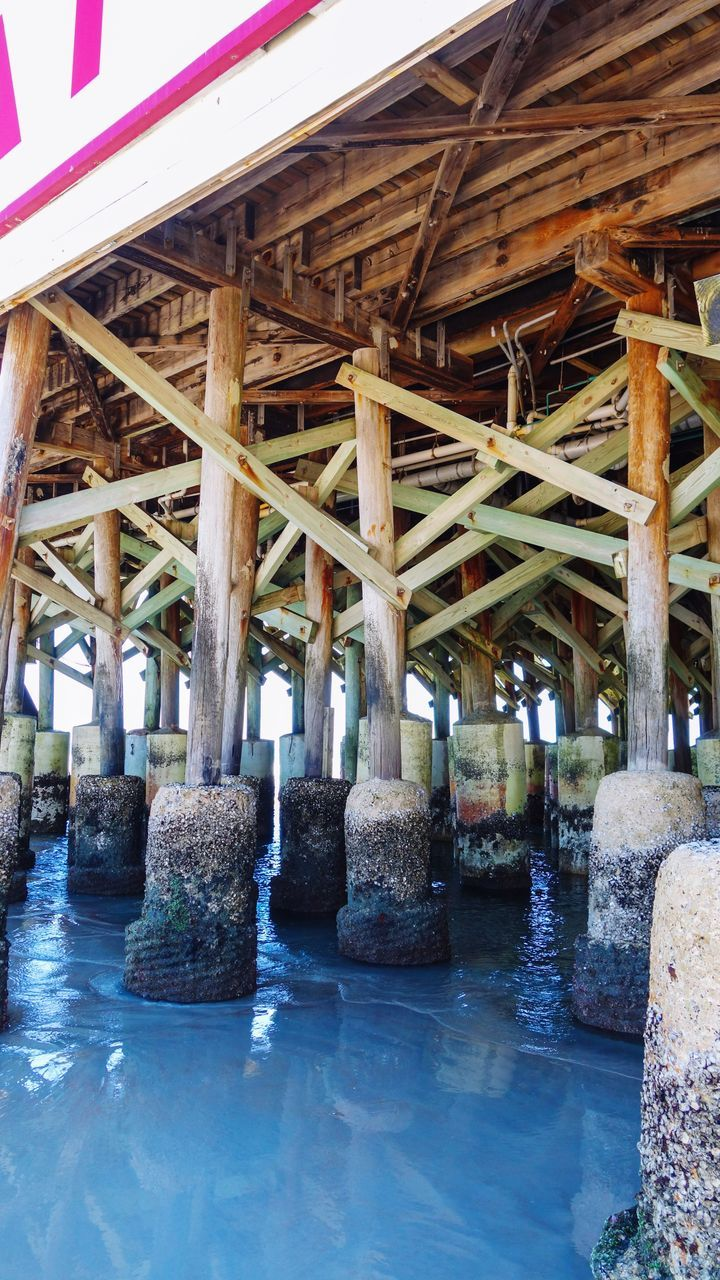 architecture, architectural column, water, underneath, built structure, bridge - man made structure, below, day, sea, no people, indoors, nature