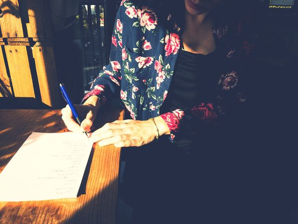Real People Women Indoors  Young Women Well-dressed Notes Writer Desk Writing Table Writing Instrument NotePad Wooden Desk Shopping List Sunlight And Shadow Human Hands Human Body Part Human Hand Pen Pencil List