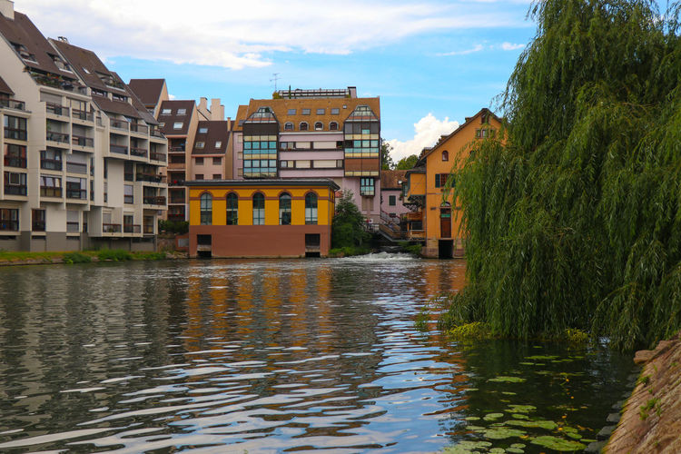 Canal in Strasbourg Architecture Built Structure Building Exterior Water Sky Building Waterfront Reflection Nature Day City No People Plant Cloud - Sky Residential District River Tree Outdoors Apartment