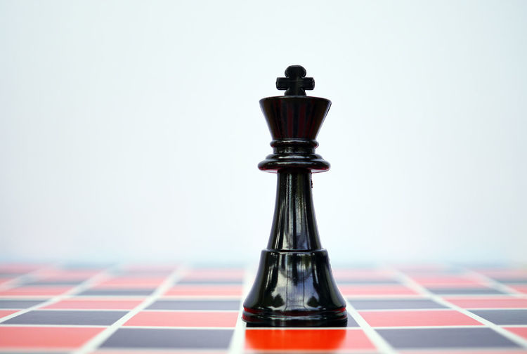 Close-up of chess piece against white background