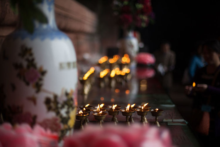 Oil lamps on counter at temple