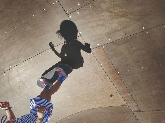 High angle view of girl skateboarding