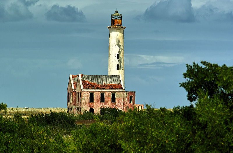 The derelict lighthouse on the tiny island of Klein-Curaçao Architecture Beauty In Nature Building Exterior Built Structure Day Derelict Lighthouse Grass Guidance Klein-Curacao Lighthouse Lookout Tower Nature No People Outdoors Protection Safety Sea Sky Tower