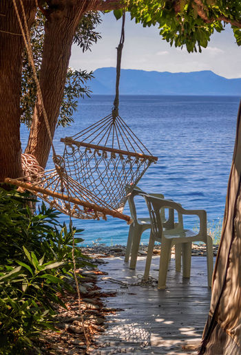 Beach Beauty In Nature Chair Day Hammock Horizon Over Water Nature Outdoors Relaxation Scenics Sea Sky Tourist Resort Tranquil Scene Tranquility Tree Tree Trunk Vacations Water