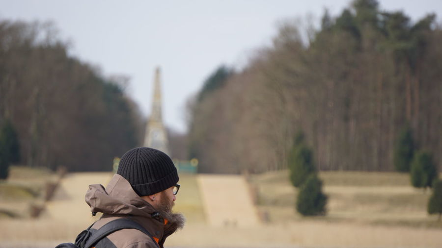Side view of man wearing warm clothing in park