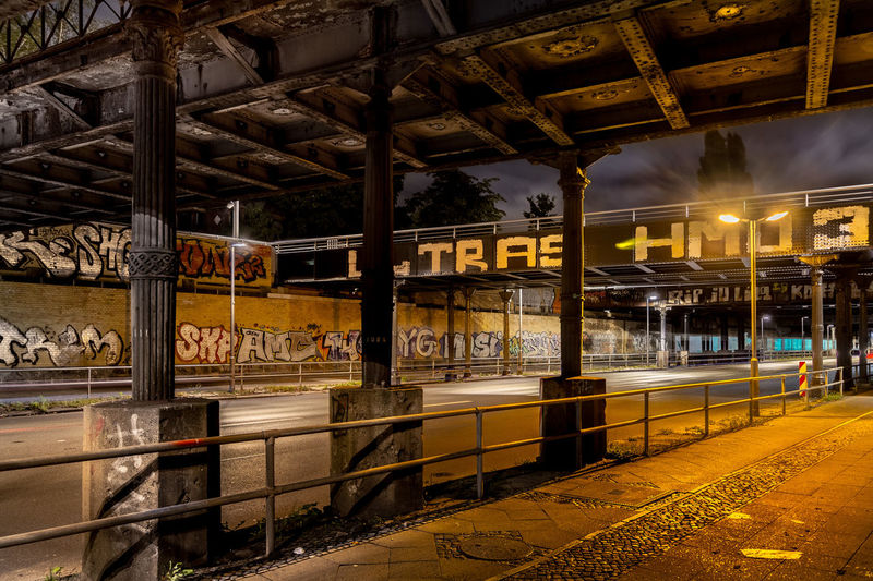 View of railroad station platform at night