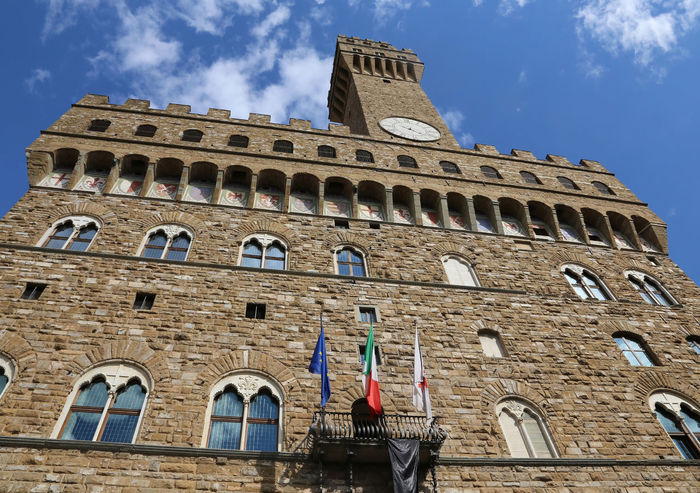 Florence Italy Historic clock tower building called Palazzo Vecchio in the Signoria square #Firenze #Florence Florence Italy Florence, Italy Piazza Della Signoria Firenze Toscana Travel Tuscany Architecture Building Exterior Built Structure Europe Florence Italy Low Angle View Medieval Medieval Architecture Monument Old Old Palace Palace Palazzo Vecchio Piazza Della Signoria Town Hall Travel Destinations