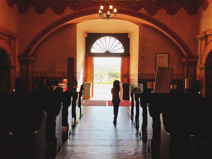 Here comes the bride Architecture Arch Built Structure Real People Indoors  Building Men Lifestyles Place Of Worship Seat Adult Religion Flooring Standing Day One Person Women Silhouette Full Length Entrance