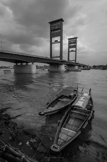 a couple of transportation boat on musi river near ampera bridge Palembang Palembang Ampera Indonesia_photography Mode Of Transport Moored No People Transportation Travel Destinations