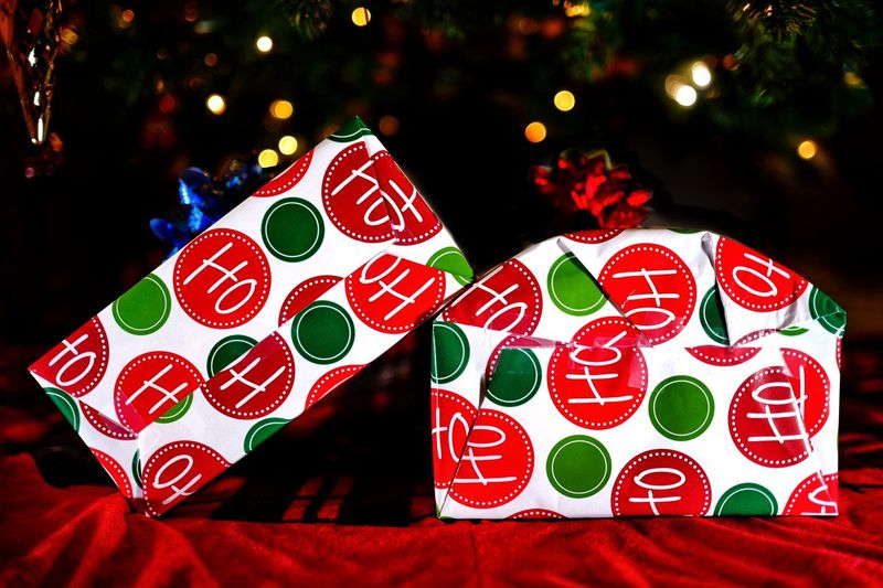 Christmas gifts Xmas Childhood Memories Childhood Wrapped Happiness Decoration Holiday Santa Claus Excitement Surprise Gift Surprise Christmas Day Christmas Celebration Red Holiday No People Tree Decoration Close-up Christmas Decoration Focus On Foreground Illuminated Still Life christmas tree Heart Shape Gift Christmas Ornament
