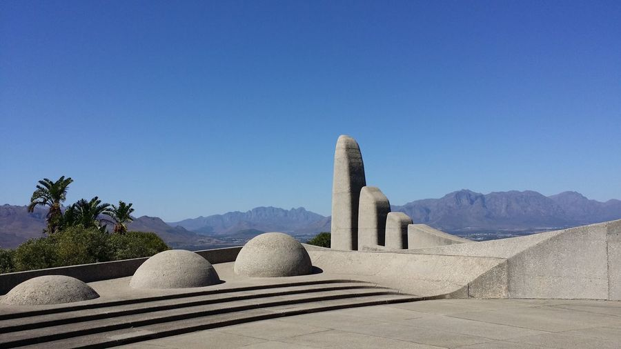 Concrete built structures against clear sky at taal monument
