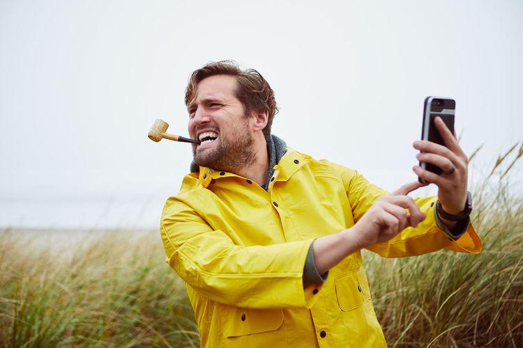 Man Taking Selfie At Beach
