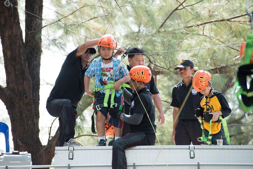 Playground zip line for children. Children Playing Excitement Height Helmet Outdoor Park Playground Recreation  Safety Equipment Zipline Adventure