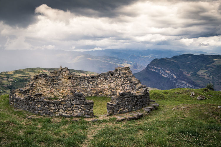 Kuelep ruins. Cloud - Sky Sky Mountain Nature History Environment Plant Scenics - Nature Landscape Day Land The Past No People Travel Destinations Architecture Tranquility Tranquil Scene Beauty In Nature Grass Travel Mountain Range Outdoors Ancient Civilization Ruined