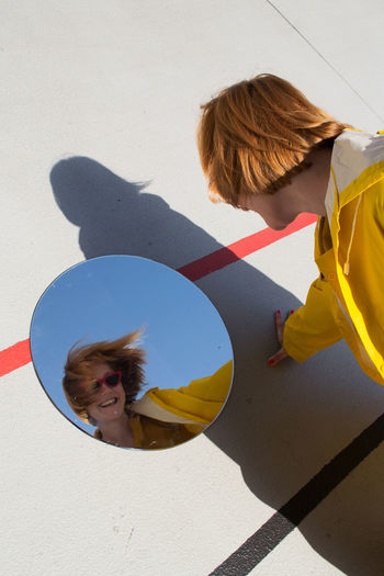 Fun Happy Having Fun Joyful Mirror Red Head Reflection Colorful Emotion Females Gingerhair Girls Hairstyle Joy Leisure Activity Lifestyles Outdoors People Round Shadow Sky Women Yellow Color Young Adult Young Women