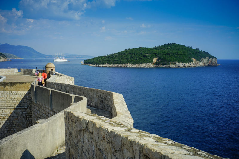 Top view of Dubrovnik, Croatia Water Sea Sky Scenics - Nature Beauty In Nature Real People Architecture Day Nature Built Structure Mountain Lifestyles Tranquility Tranquil Scene Leisure Activity Sunlight Standing People Non-urban Scene Outdoors Game Of Thrones Croatia Old Town Top View Shot