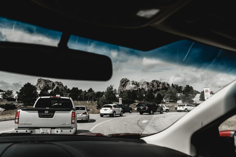 Cars on road seen through car windshield
