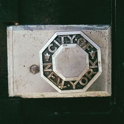 City of New York doorknob. I've been wanting to take a photo of this every time I walk past this house, but there's always people around. I'm not a creeper :'(