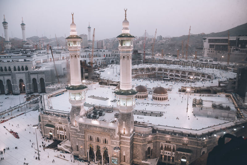 High angle view of kaaba in city at dusk