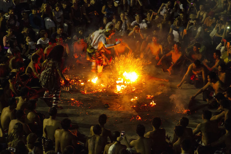 Dance INDONESIA Theater Arts Culture And Entertainment Bonfire Burning Celebration Crowd Cultures Event Flame Heat - Temperature Kchak Large Group Of People Men Night Outdoors People Performance Real People Tradition Traditional Festival Women