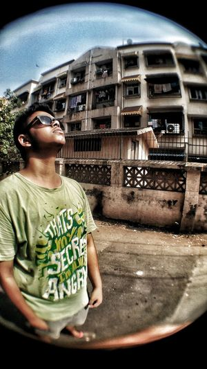 Portrait of boy wearing sunglasses against car