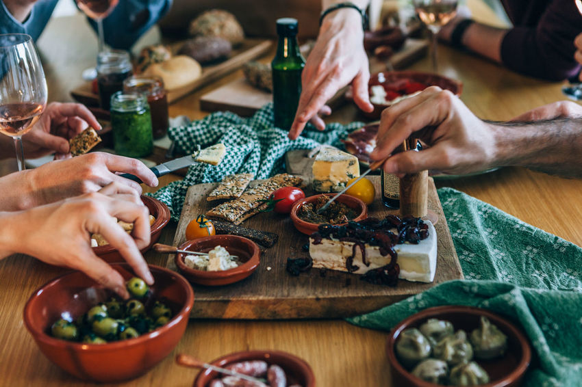 hands picking food on a party table Party Food Ready To Eat Tapas Appetizer Close-up Day Food Food And Drink Freshness Grabbing Holding Human Body Part Human Hand Indoors  Men One Person People Picking Picking Flowers  Real People Table Togetherness Working