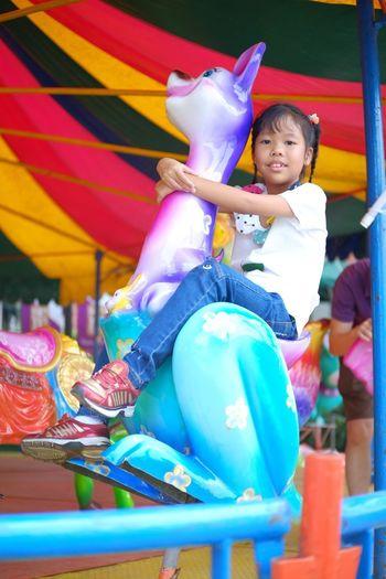 Full length of a smiling girl in amusement park